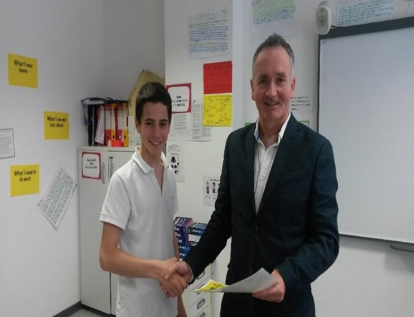 Ruggero receiving his certificate from Mr Rafferty