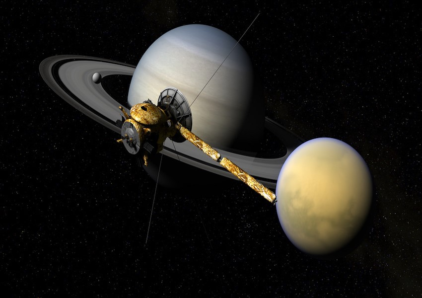 Cassini+moving+over+Titan%2C+Enceladus+and+Saturn